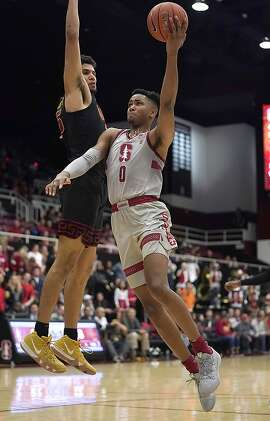 Stanford forward KZ Okpala (0) drives to the basket against Southern California forward Bennie Boatwright (25) during the second half of an NCAA college basketball game Wednesday, Feb. 13, 2019, in Stanford, Calif. (AP Photo/Tony Avelar)