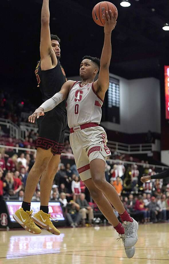 Stanford forward KZ Okpala (0) drives to the basket against Southern California forward Bennie Boatwright (25) during the second half of an NCAA college basketball game Wednesday, Feb. 13, 2019, in Stanford, Calif. (AP Photo/Tony Avelar) Photo: Tony Avelar / Associated Press