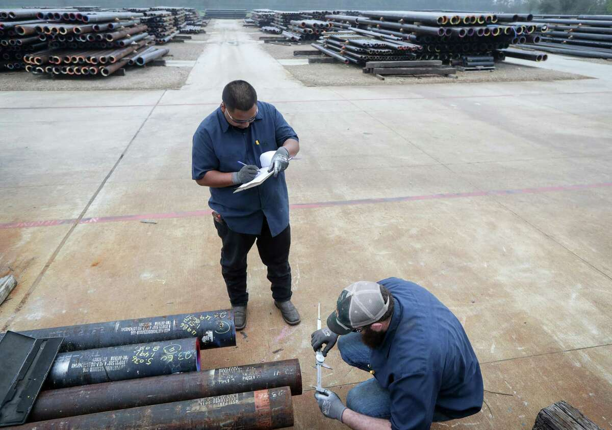 Lean Lares, standing, a shop foreman, and Cale LaBarge, a materials handler, check the specifications of a piece of steel at McMahon Steel Supply. Texas companies, including McMahon, accounted for one in five requests for exemptions from U.S. steel tariffs in 2018.