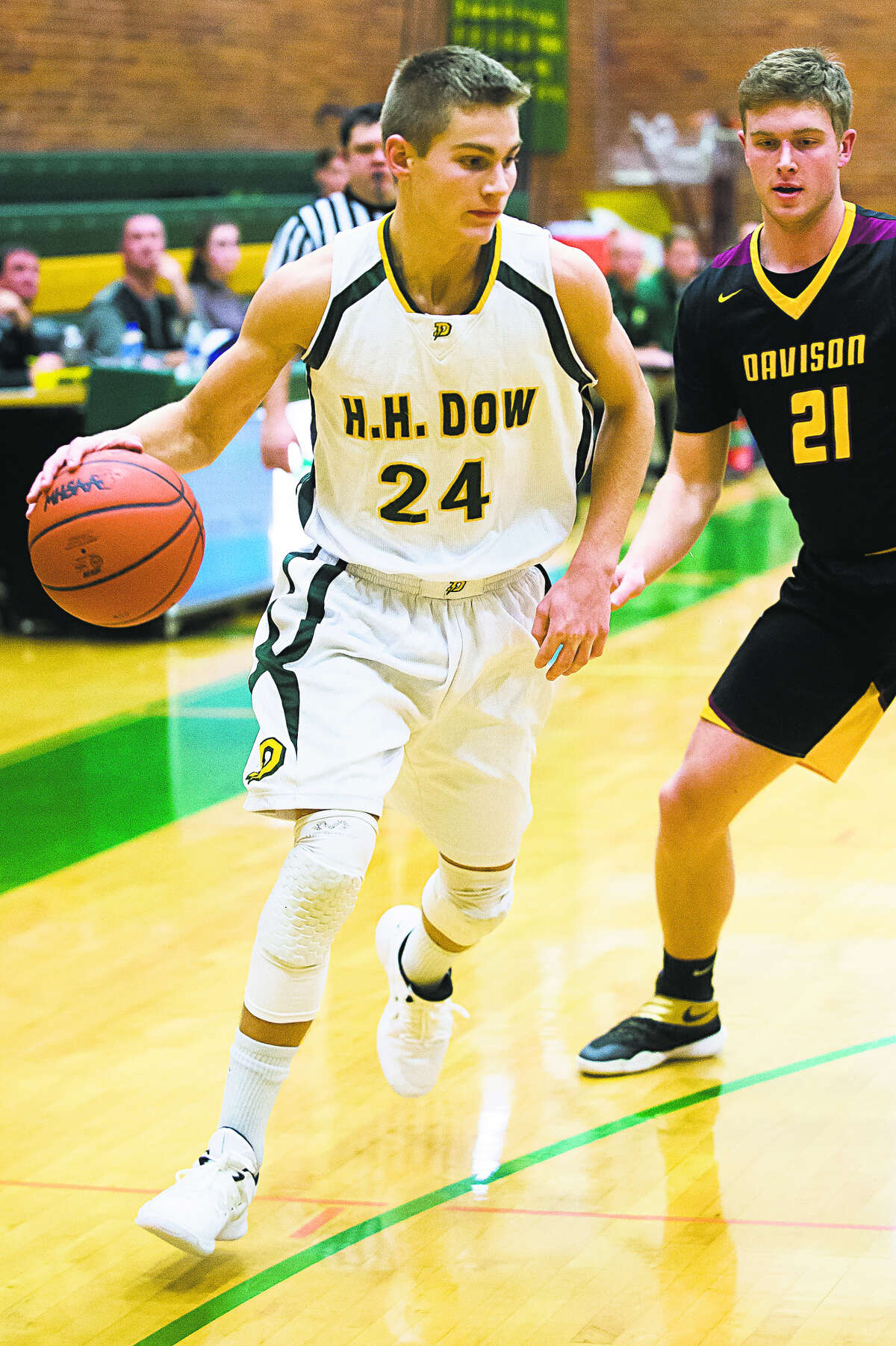 Dow High's Isaac Moolenaar looks for an opening during a Nov. 30, 2018 game against Davison.