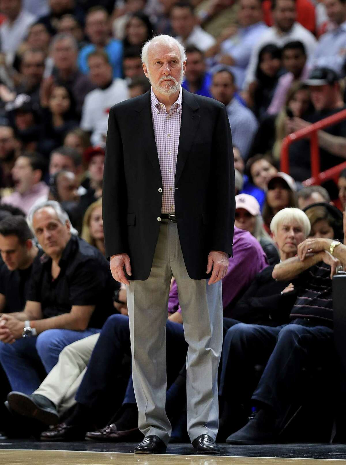 MIAMI, FL - OCTOBER 25: Head coach Gregg Popovich of the San Antonio Spurs looks on during a game against the Miami Heat at American Airlines Arena on October 25, 2017 in Miami, Florida. NOTE TO USER: User expressly acknowledges and agrees that, by downloading and or using this photograph, User is consenting to the terms and conditions of the Getty Images License Agreement. (Photo by Mike Ehrmann/Getty Images) ORG XMIT: 775026707