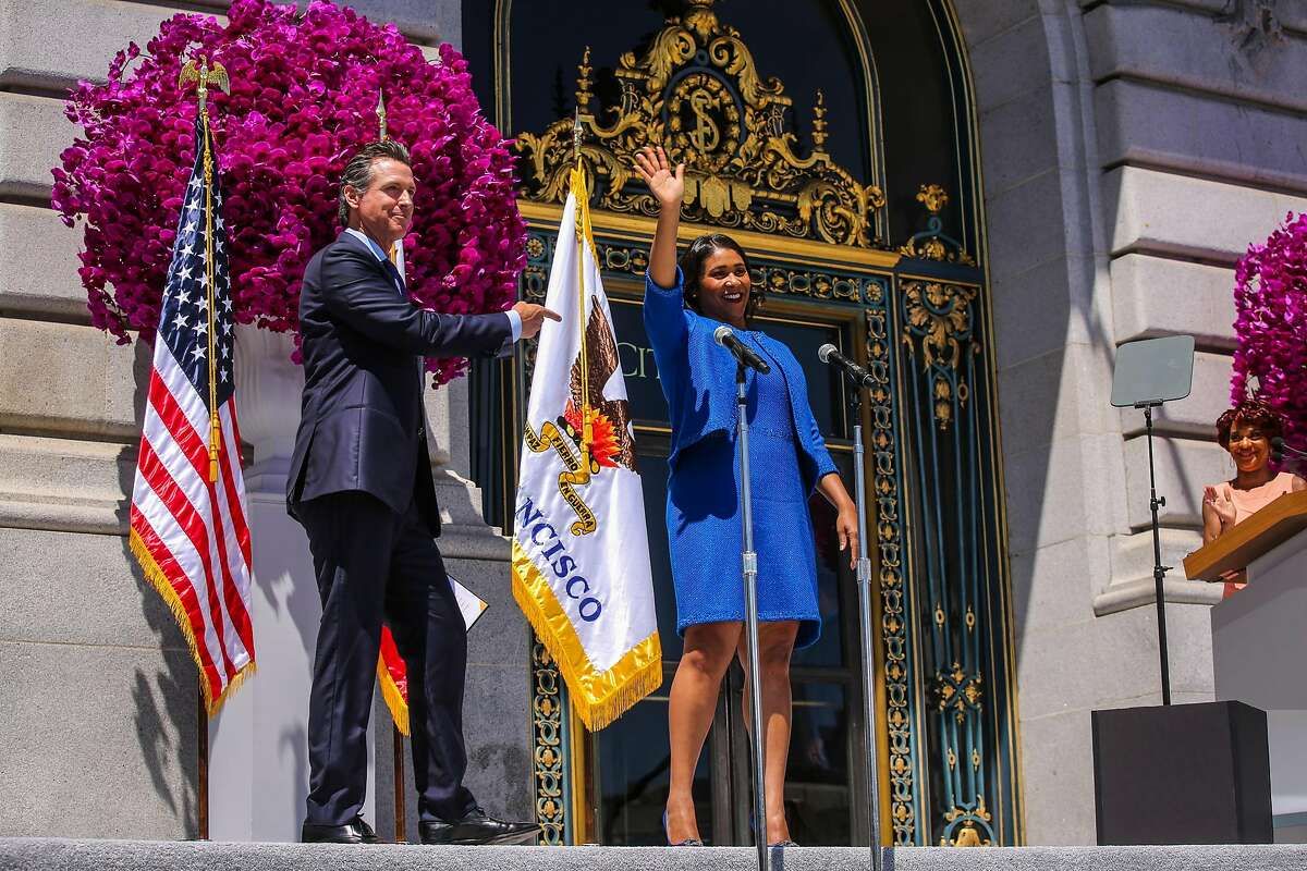 Mayor London Breed waves to the crowd moments after taking the oath of office during the inauguration outside City Hall in San Francisco, California, on Wednesday, July 11, 2018.