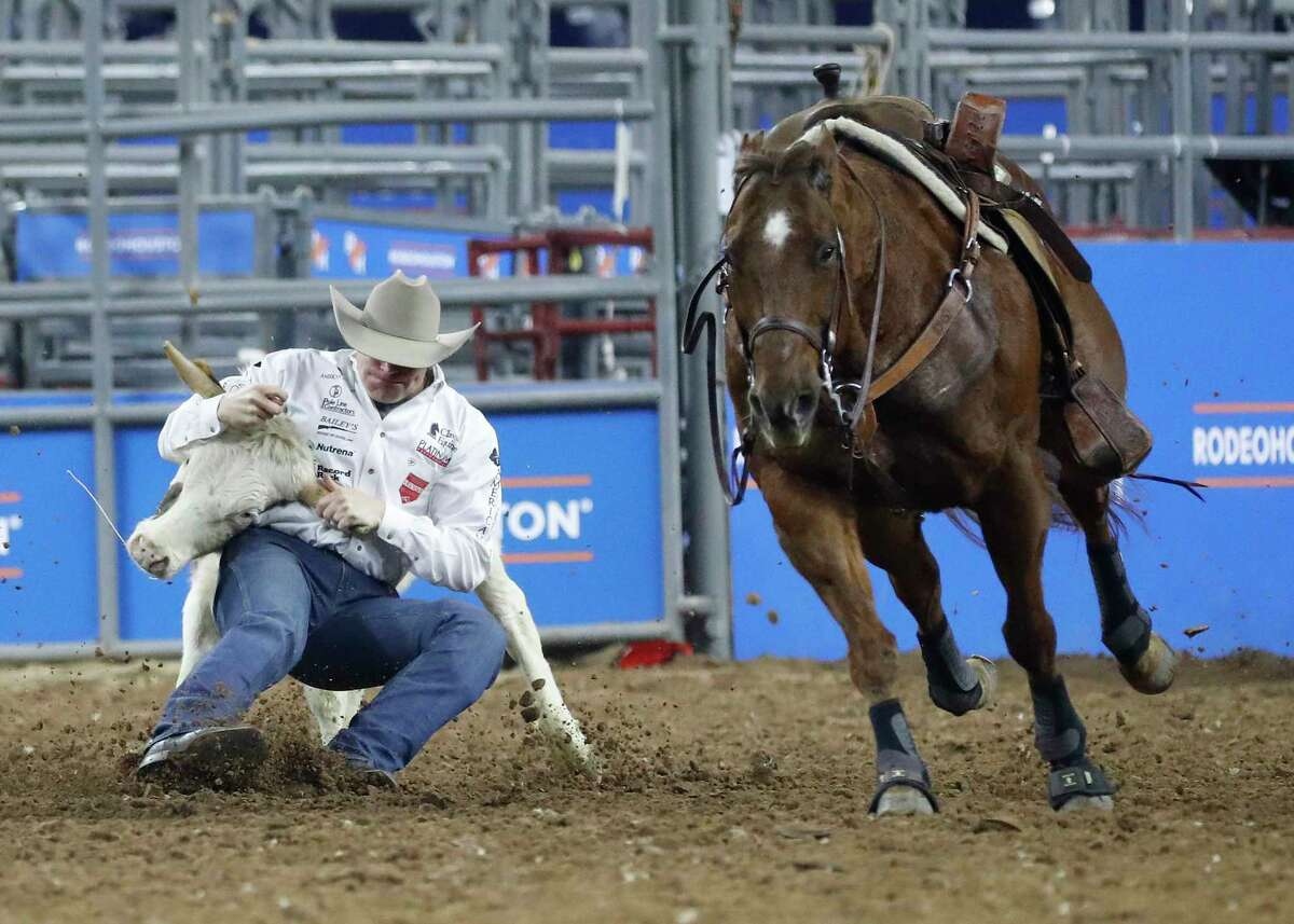Dakota Eldridge takes down a steer in 3.5 seconds as he competed in the steer wrestling competition during round 2 of Super Series I of the Houston Livestock Show and Rodeo at NRG Stadium, Tuesday, Feb. 26, 2019, in Houston.