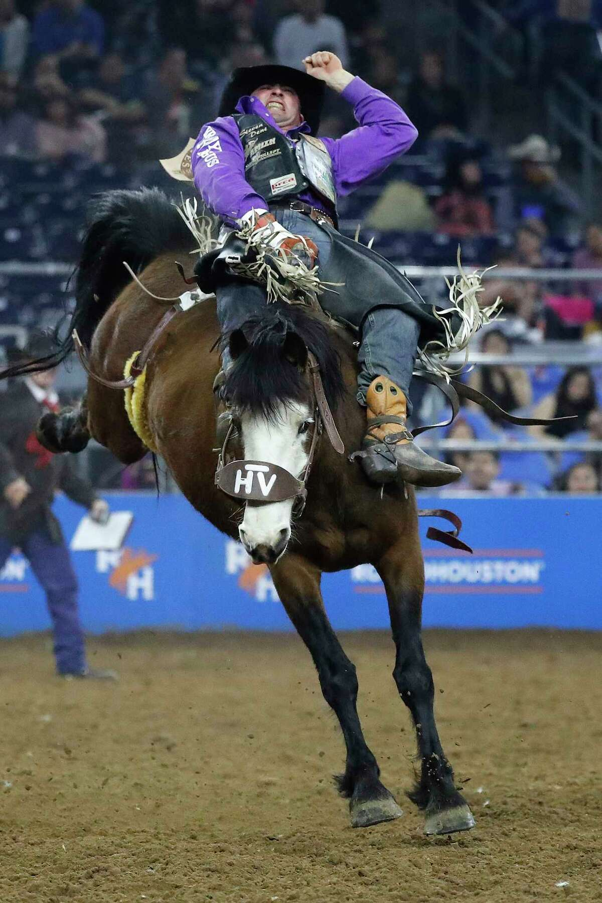 Steven Dent rides Misty Valley as he competed in the bareback riding competition during round 2 of Super Series I of the Houston Livestock Show and Rodeo at NRG Stadium, Tuesday, Feb. 26, 2019, in Houston.