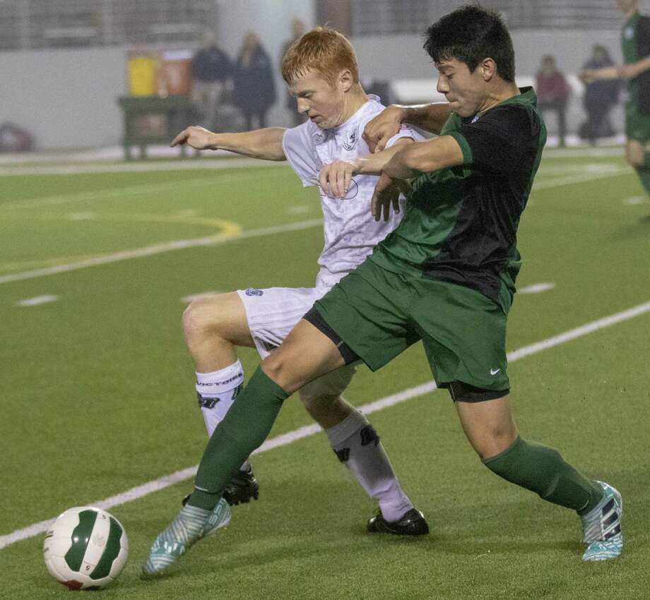 College Park midfielder Jonathon Letai (13) and The Woodlands midfielder Thomas Silva (7) compete for the ball during a District 15-6A soccer match Tuesday, Feb. 26, 2019 at Woodforest Bank Stadium in The Woodlands. Photo: Cody Bahn, Houston Chronicle / Staff Photographer / © 2018 Houston Chronicle
