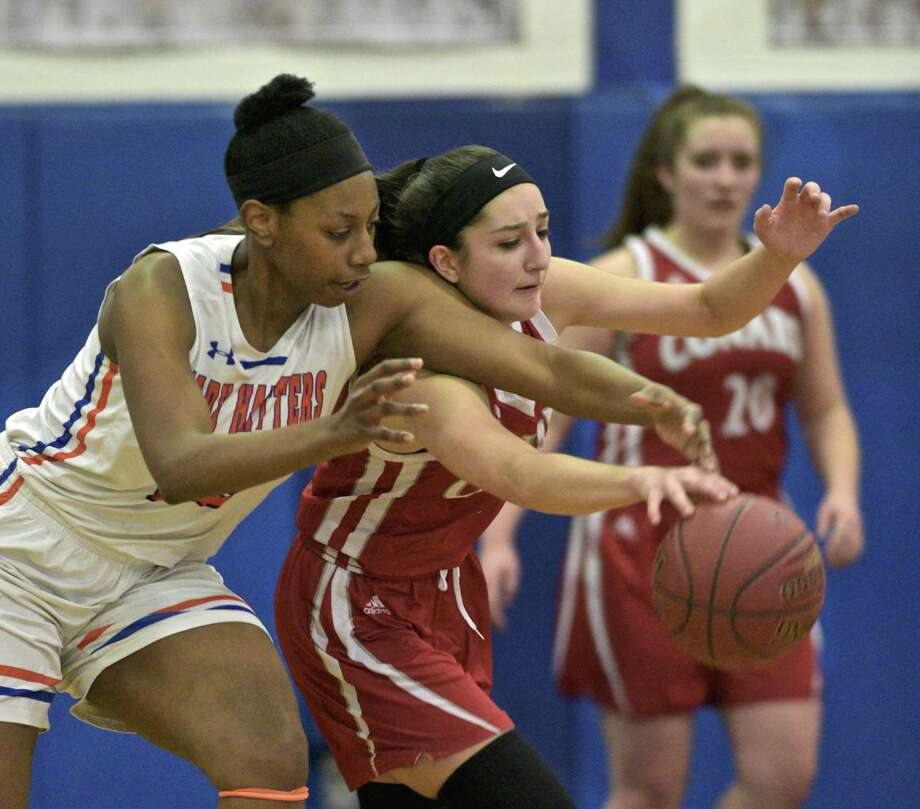 Danbury's Tanisha Cunningham, left, and Conard's Isabella Mocadlo fight for the ball in Tuesday's Class LL game at Danbury High School. Photo: H John Voorhees III / Hearst Connecticut Media / The News-Times