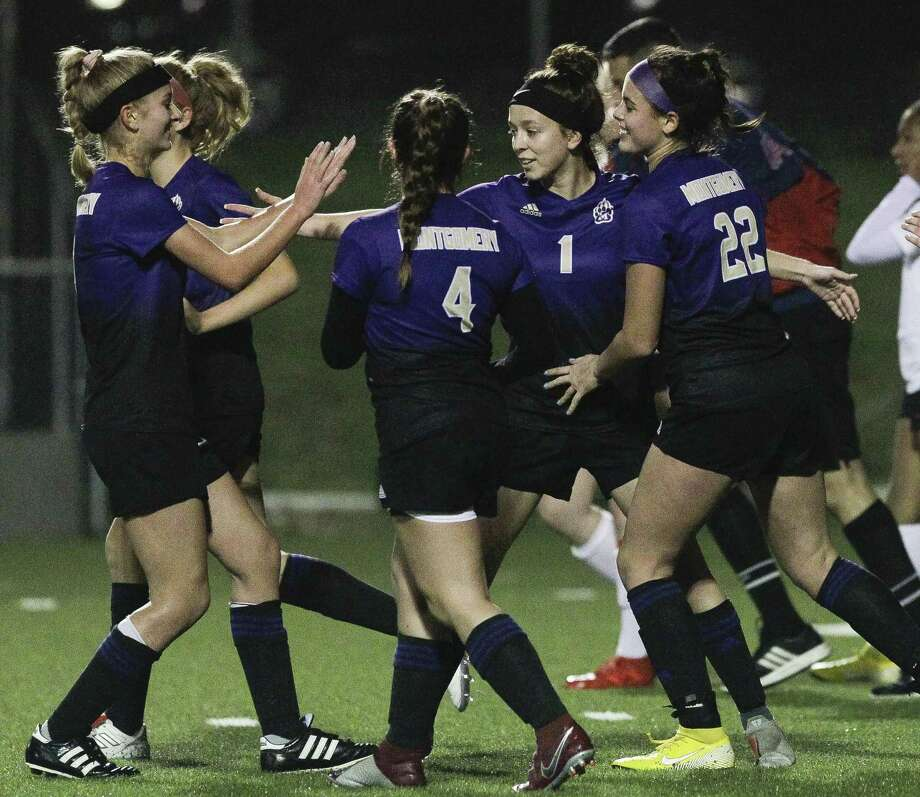 Montgomery players celebrate after a goal by Taryn Hood, center, during the first period of a District 20-5A high school soccer match at Montgomey High School, Tuesday, Feb. 26, 2019, in Montgomery. Photo: Jason Fochtman, Houston Chronicle / Staff Photographer / © 2019 Houston Chronicle