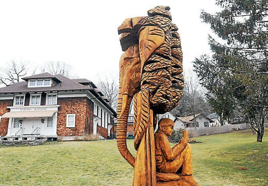 A sculpture outside the Ivoryton Playhouse was carved from a felled tree from Hurricane Sandy. The playhouse is hosting a festival of women's plays March 1-2 Photo: File Photo / Hearst Connecticut Media
