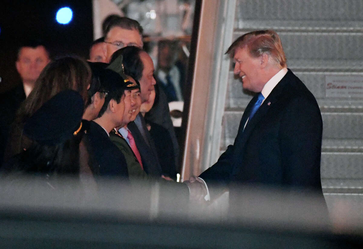 President Donald Trump is greeted after arriving on Air Force One at Noi Bai International Airport, in Hanoi, Vietnam, Tuesday, Feb. 26, 2019, ahead of his second summit with North Korea's Kim Jong Un, scheduled for Wednesday. (AP Photo/Susan Walsh)
