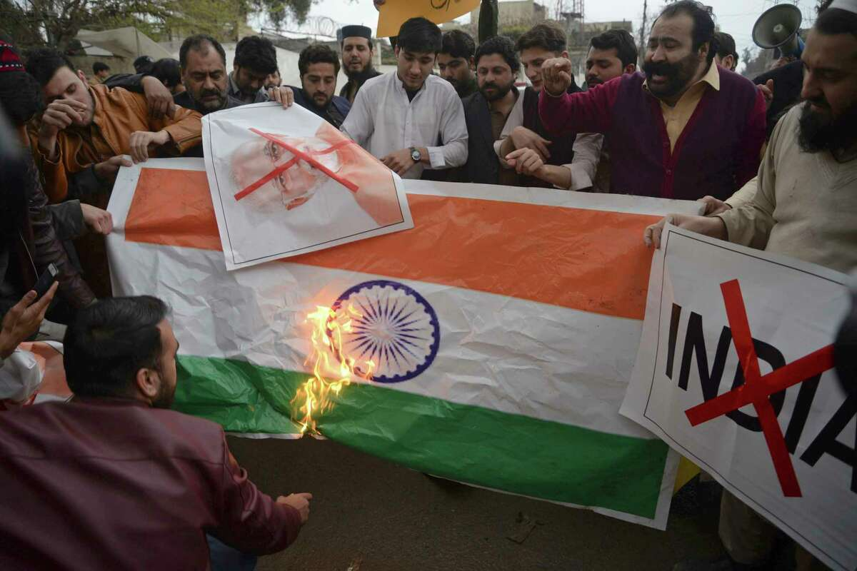 Pakistani protesters burn a representation of an Indian flag during an anti-Indian rally in Peshawar, Pakistan, Tuesday, Feb. 26, 2019. Pakistan said India launched an airstrike on its territory early Tuesday that caused no casualties, while India said it targeted a terrorist training camp in a pre-emptive strike that killed a