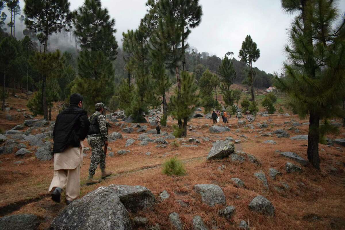 Pakistani reporters and troops visit the site of an Indian airstrike in Jaba, near Balakot, Pakistan, Tuesday, Feb. 26, 2019. Pakistan said India launched an airstrike on its territory early Tuesday that caused no casualties, while India said it targeted a terrorist training camp in a pre-emptive strike that killed a