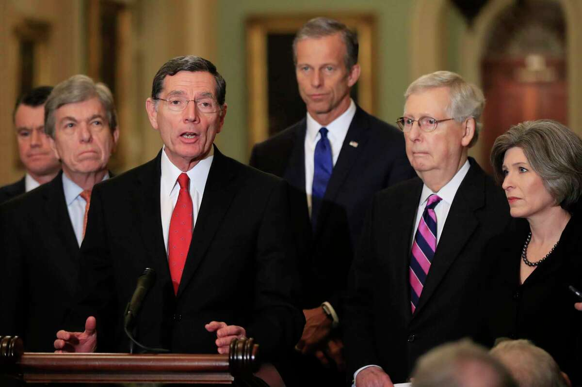 Sen. John Barrasso, R-Wyo., with, from left, Sens. Todd Young, R-In., Roy Blunt, R-Mo., Barasso, John Thune, R-S.D., Senate Majority Leader Mitch McConnell, R-Ky., and Joni Ernst, R-Iowa, speaks to reporters on Capitol Hill in Washington, Tuesday, Feb. 26, 2019. (AP Photo/Manuel Balce Ceneta)