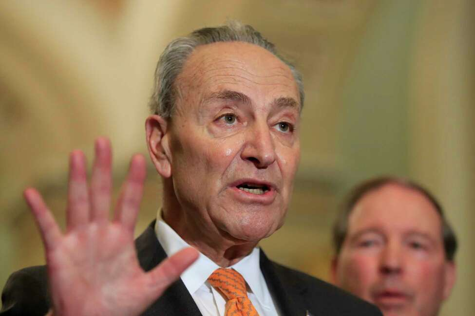 Senate Minority Leader Chuck Schumer of N.Y. with Sen. Tom Udall, D-N.M., speaks to reporters on Capitol Hill in Washington, Tuesday, Feb. 26, 2019. (AP Photo/Manuel Balce Ceneta)