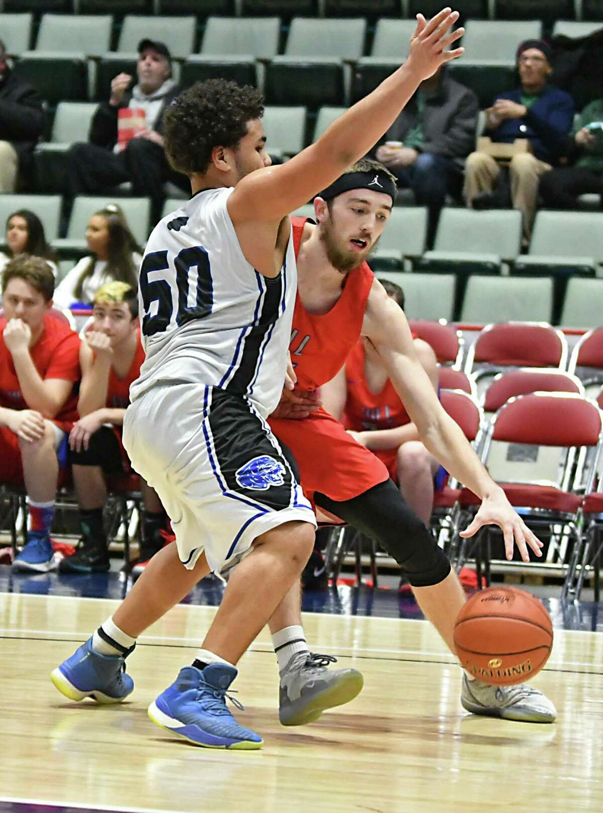 Hoosick Falls' Dmitri Rose defends Maple Hill's Nate Mannion during a Class C basketball semifinal game at the Cool Insuring Arena on Tuesday, Feb. 26, 2019 in Glens Falls, N.Y. (Lori Van Buren/Times Union)