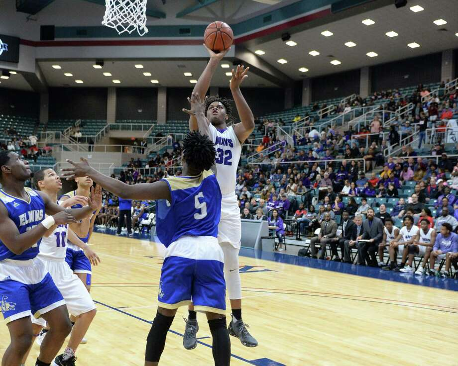 Eddie Lampkin (32) of Morton Ranch attempts a shot over Tyler Callegari (5) of Elkins during the second half of a Class 6A, Region III boy's basketball quarter final game between the Morton Ranch Mavericks and the Elkins Knights on Tuesday, February 26, 2019 at the Merrell Center, Katy, TX. Photo: Craig Moseley, Staff Photographer / ©2019 Houston Chronicle