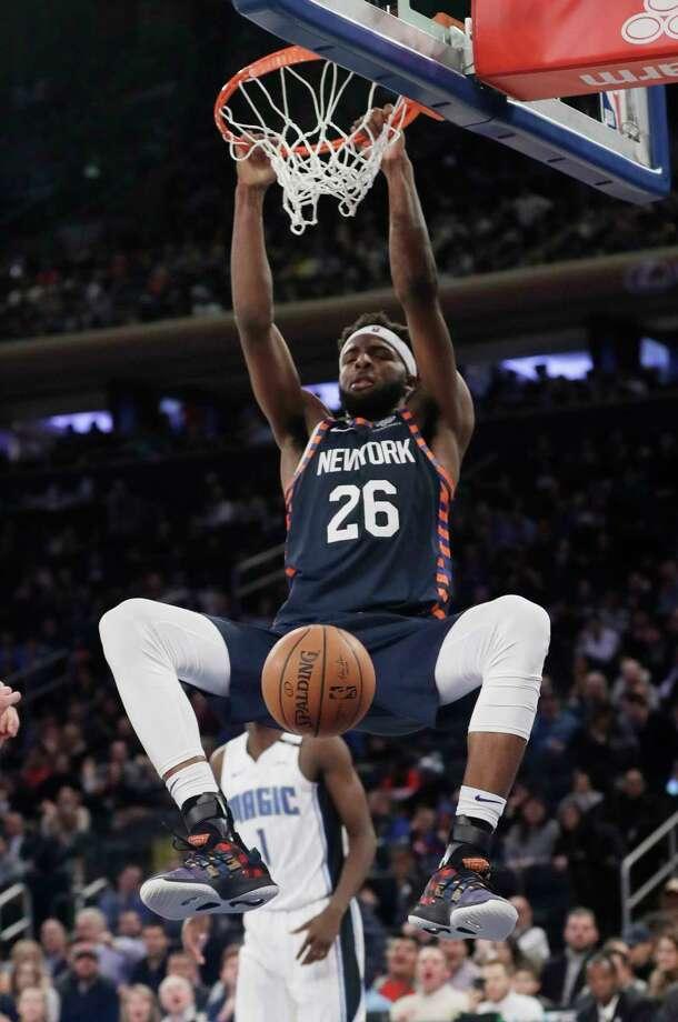 2498b90fe92 New York Knicks  Mitchell Robinson (26) dunks in front of Orlando Magic s  Jonathan