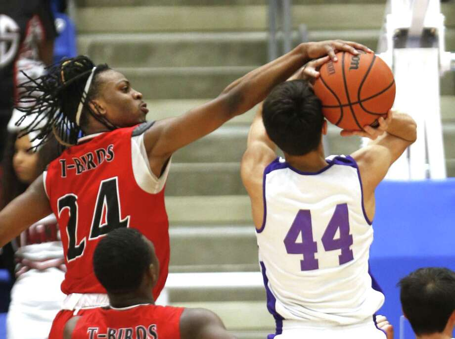 Wagners' Journee Phillips (C) blocks shot attempt of Brackenridges' Zebastian Meza from the UIL Class 5A third-round high school boys basketball game between Wagner and Brackenridge on Tuesday, February 26, 2019. Photo: Ronald Cortes/Contributor / 2018 Ronald Cortes