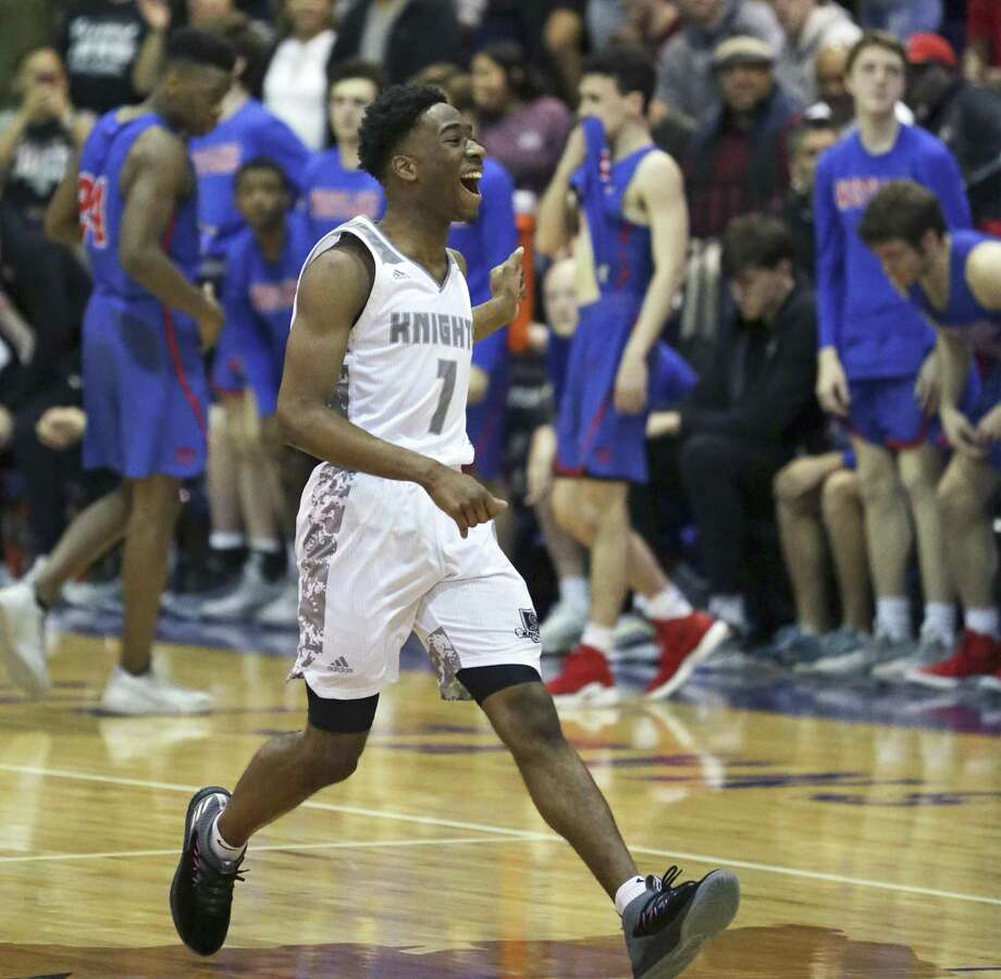 Steele senior guard DeVaughn Rider runs back to his teammates in celebration after the Knights finished off their 73-66 overtime victory over Austin Westlake in Tuesday night's playoff game. Photo: Tom Reel / Staff Photographer / 2019 SAN ANTONIO EXPRESS-NEWS