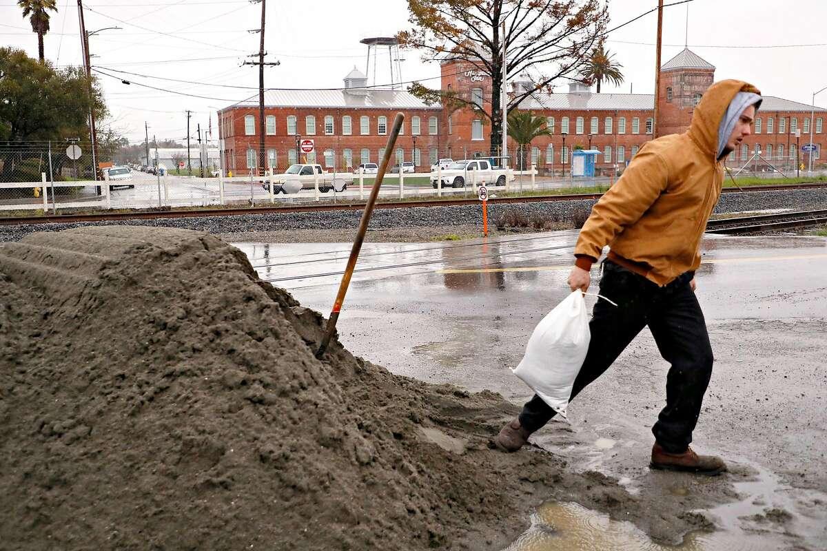 Justin Corso fills sandbags in preparation of the coming storm on Tuesday, Feb. 26, 2019, in Petaluma, CA.