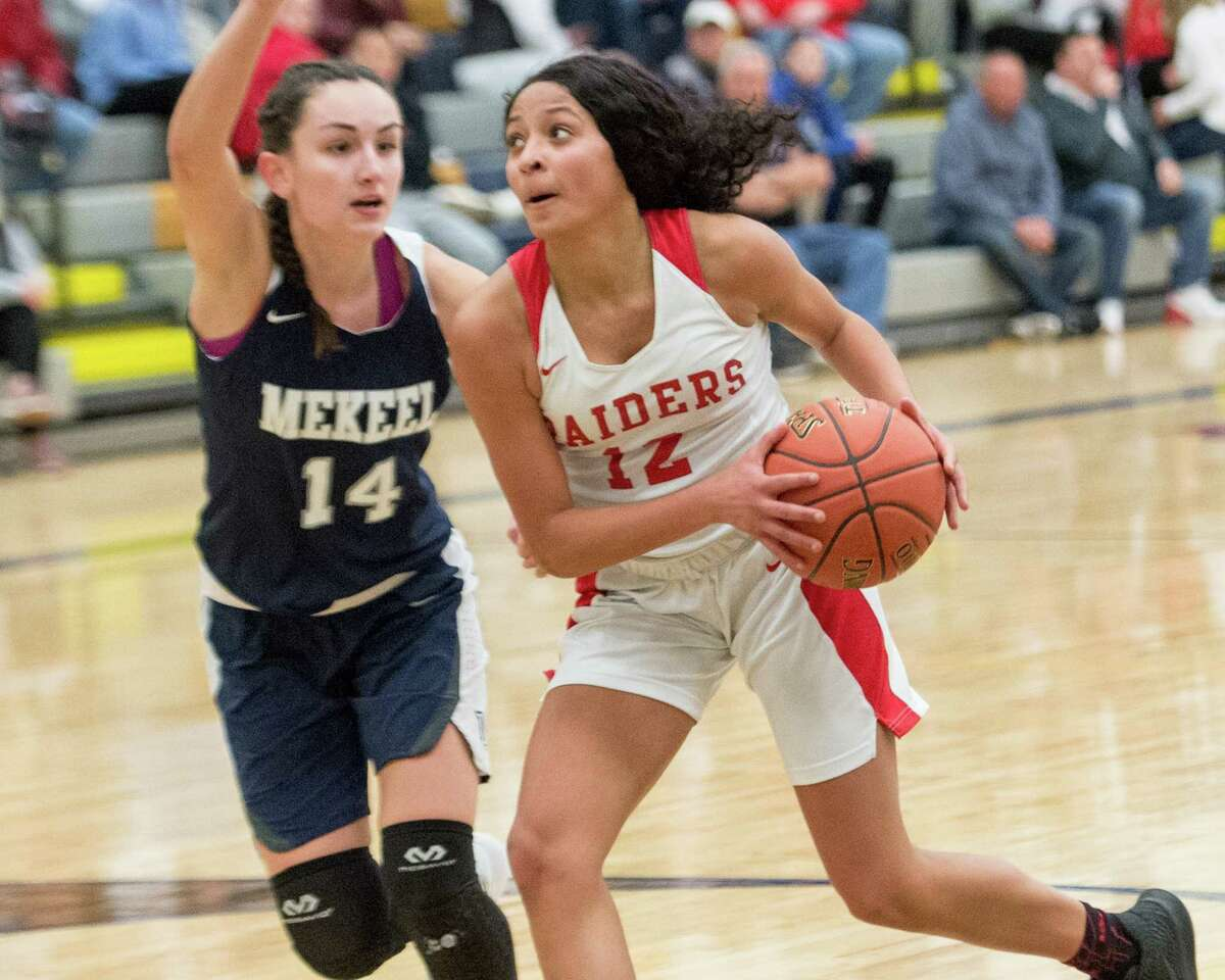 Mechanicville?s Jada Brown drives to the basket in front of Mekeel Christian Academy?s Madison Snow during the Section II, Class B semifinals at Averill Park High School on Tuesday, Feb. 26, 2019. (Jim Franco/Special to the Times Union)