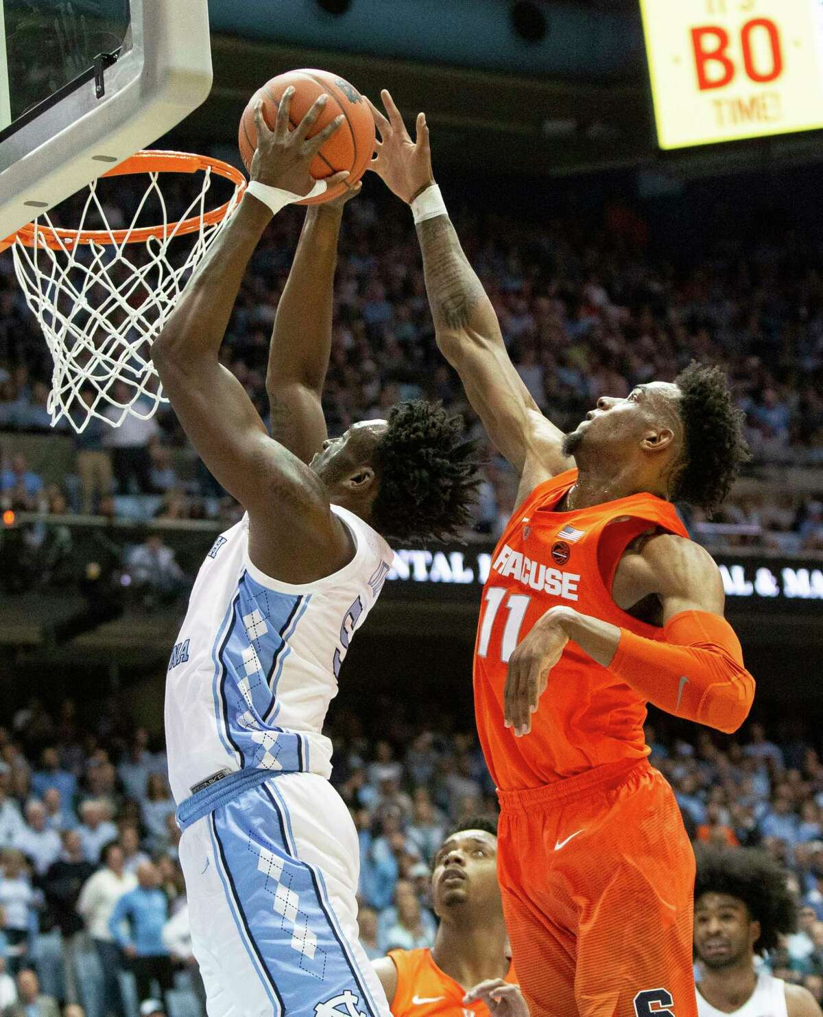 Syracuse's Oshae Brissett, right, blocks the shot of North Carolina's Nassir Little, left, during the second half of an NCAA college basketball game in Chapel Hill, N.C., Tuesday, Feb. 26, 2019. (AP Photo/Ben McKeown)
