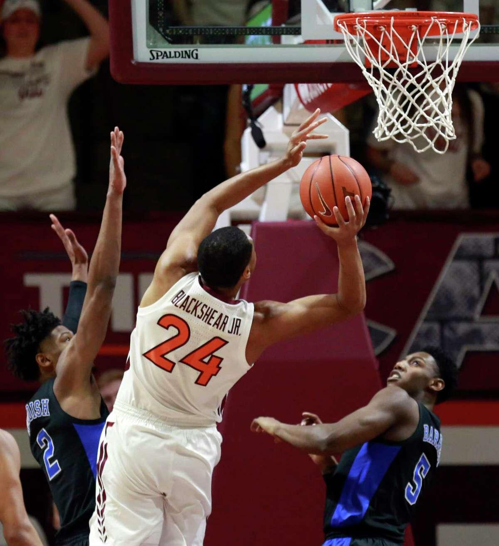 Virginia Tech's Kerry Blackshear Jr. (24) scores over Duke's Cam Reddish (2) and RJ Barrett (5) of Duke during the first half of an NCAA college basketball game in Blacksburg, Va., Tuesday, Feb. 26, 2019. (Matt Gentry/The Roanoke Times via AP)