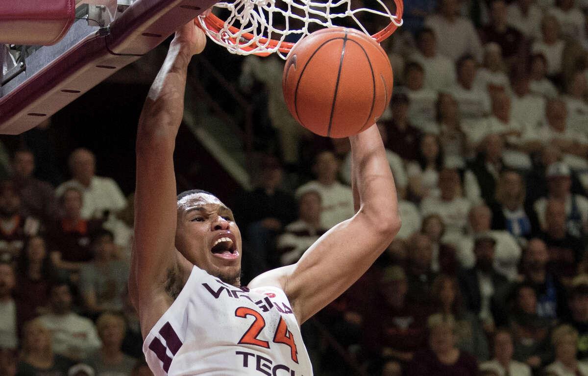 Virginia Tech forward Kerry Blackshear Jr. dunks against Duke during the second half of an NCAA college basketball game in Blacksburg, Va., Tuesday, Feb. 26, 2019. (AP Photo/Lee Luther Jr.)