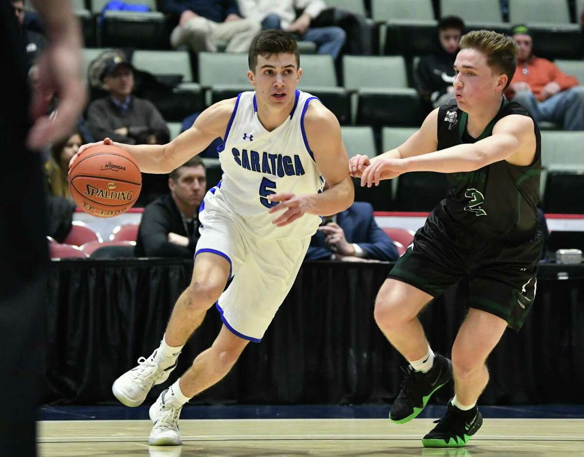 Saratoga's Aidan Holmes drives to the basket against Shenendehowa's Nick Lemire during a Class Class AA basketball semifinal game at the Cool Insuring Arena on Tuesday, Feb. 26, 2019 in Glens Falls, N.Y. (Lori Van Buren/Times Union)