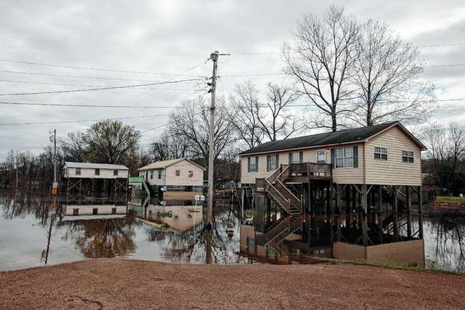 Houses on stilts stand over flood waters Tuesday in Vicksburg, Mississippi. The Mississippi River is currently at 47.48 feet in Vicksburg according to the National Weather Service and is expected to crest at 51.4 feet on March 14. The National Weather Service's spring flood outlook cites a high risk of major flooding along the Mississippi, Missouri and Illinois rivers, posing a flooding risk for portions of Illinois and Missouri. Photo: Courtland Wells | The Vicksburg Post Via AP