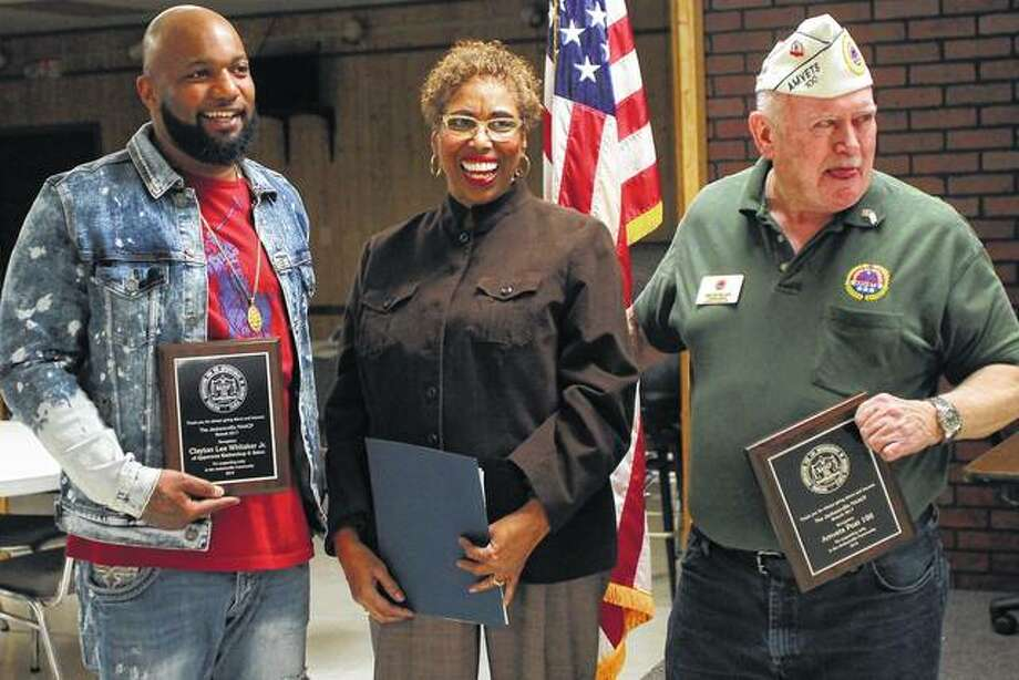 From left, Clayton Lee Whitaker Jr. of Uppercuts Barbershop and Salon, Jacksonville NAACP Secretary Doris Robinson, and Amvets 100 Post Commander Jim Duncan laugh together after Robinson presented the two men with awards from her organization. The Jacksonville NAACP chapter recognized Whitaker and the Amvets post for building unity in the Jacksonville community. They were presented with plaques Tuesday evening. Photo: Rosalind Essig | Journal-Courier