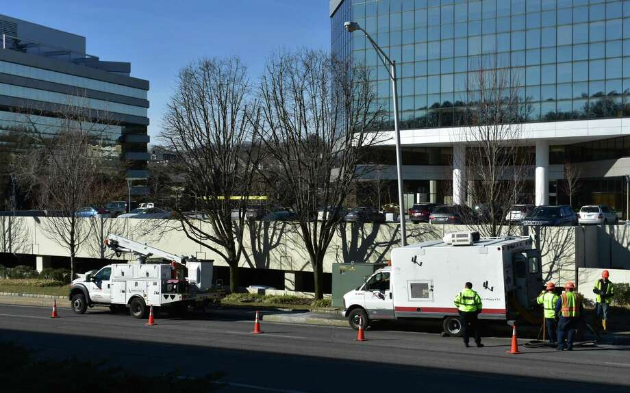 Frontier Communications crews on a February 2019 field call outside the company's headquarters office (left) at Merritt 7 Corporate Park in Norwalk, Conn. Photo: Alexander Soule / Hearst Connecticut Media / Stamford Advocate