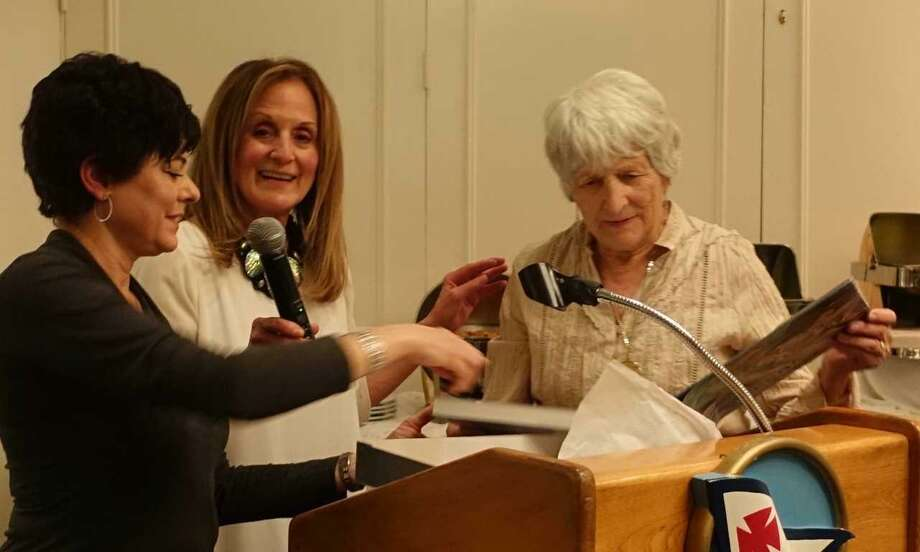 Rosmarie Nasr, right, receives the John Tatge Memorial Volunteer of the Year Award for her dedicated service to the Art Society of Old Greenwich. Co-Presidents Julie DiBiase (left) and Elaine Conner (center) present the award at the group's annual dinner and art show. Photo: Randy Briggs / Contributed /