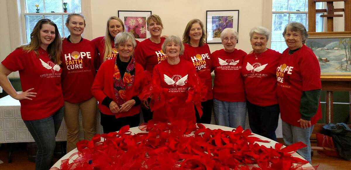 Julia's Wings Foundation in Sherman is gearing up for its March 3-10 Operation Wear Red Campaign, held in conjunction with the National Organization for Rare Diseases' Rare Disease Day. Above, volunteers gather at Sherman Senior Center to make red bows to distribute in the coming days.