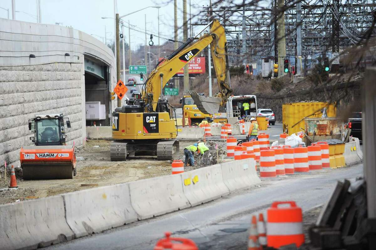 Construction workers continue the first phase of the Atlantic Street Bridge Project on South State Street in downtown Stamford, Conn.