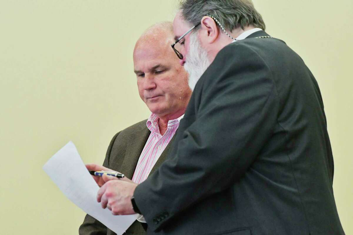 Former Troy city engineer Andrew Donovan, left, appears with his attorney, Mike McDermott, in Rensselaer County Court for the unsealing of an indictment on Wednesday, Feb. 27, 2019, in Troy, N.Y. Donovan was the focus of an investigation into his purchase of land from the city of Troy and then his subsequent effort to sell the land for a large profit. (Paul Buckowski/Times Union)