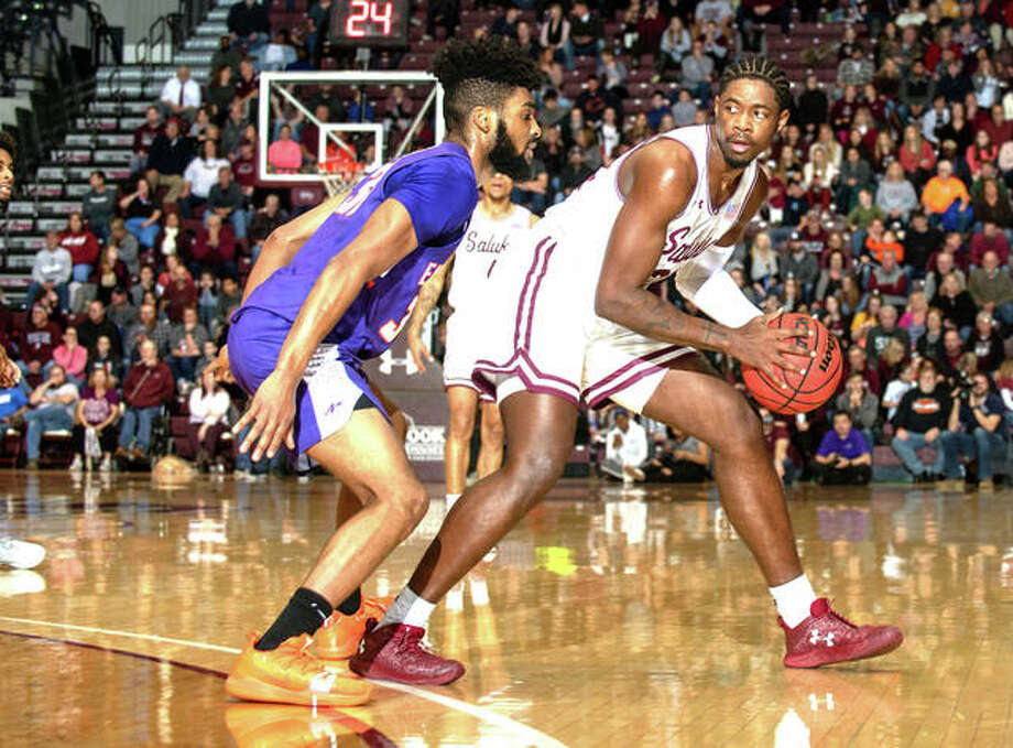 SIU Carbondale senior Armon Fletcher, a 2014 Edwardsville graduate, tries to get past a defender during a game earlier this season.