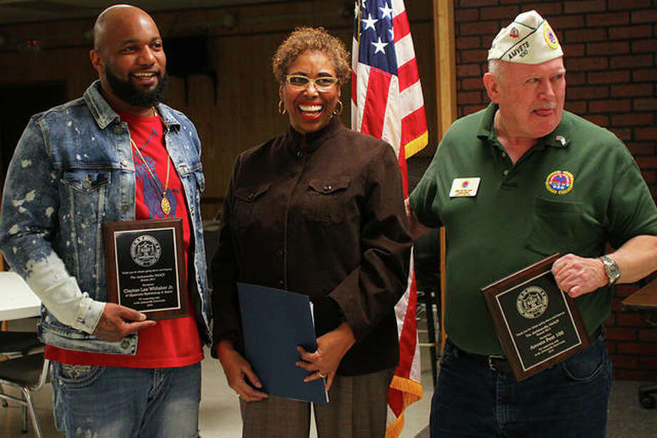 The Jacksonville NAACP chapter recognized Clayton Lee Whitaker Jr. of Uppercuts Barbershop and Salon and Amvets Post 100 for building unity in the Jacksonville community. They were presented with plaques Tuesday evening. Photo: Rosalind Essig | Journal-Courier