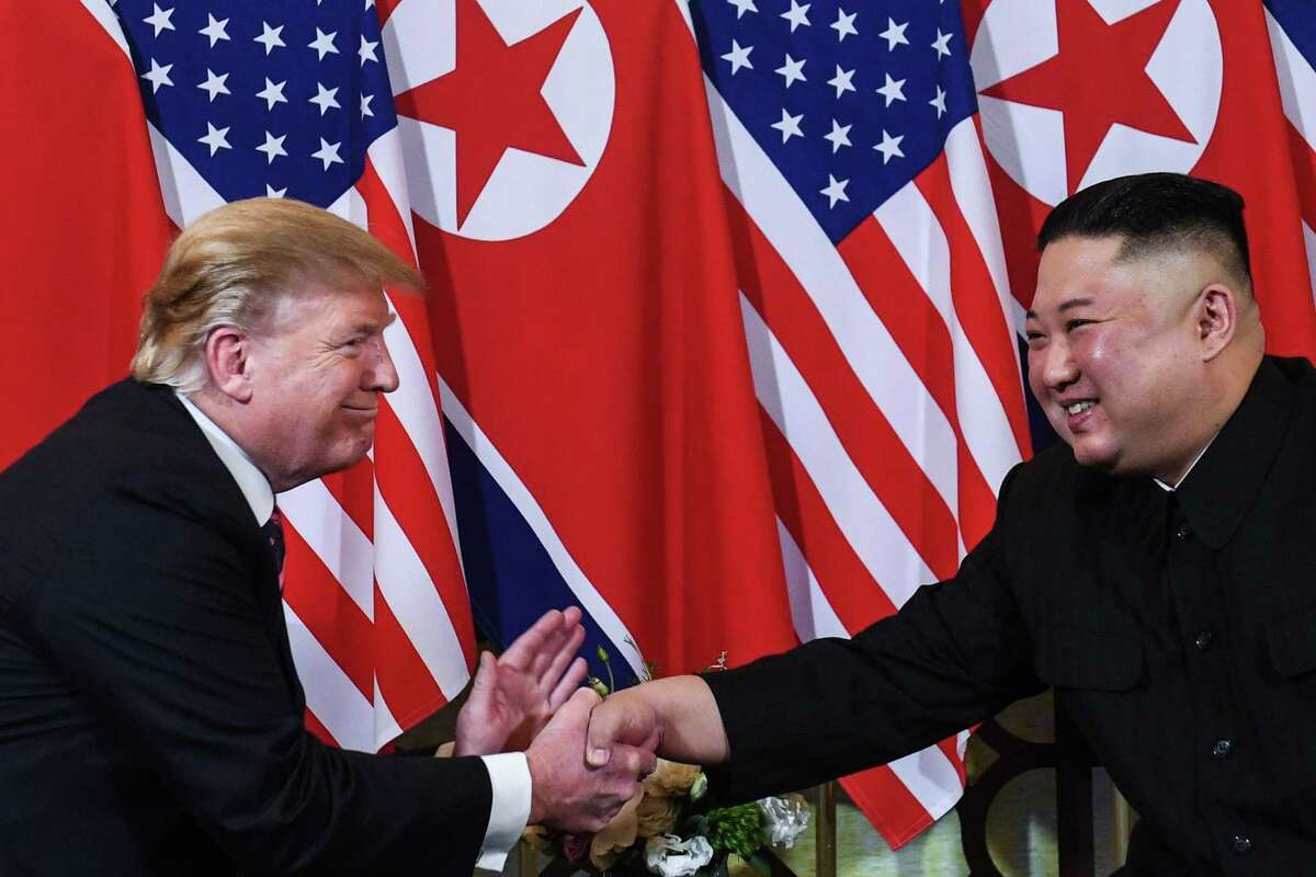 TOPSHOT - US President Donald Trump (L) shakes hands with North Korea's leader Kim Jong Un following a meeting at the Sofitel Legend Metropole hotel in Hanoi on February 27, 2019. (Photo by Saul LOEB / AFP)SAUL LOEB/AFP/Getty Images