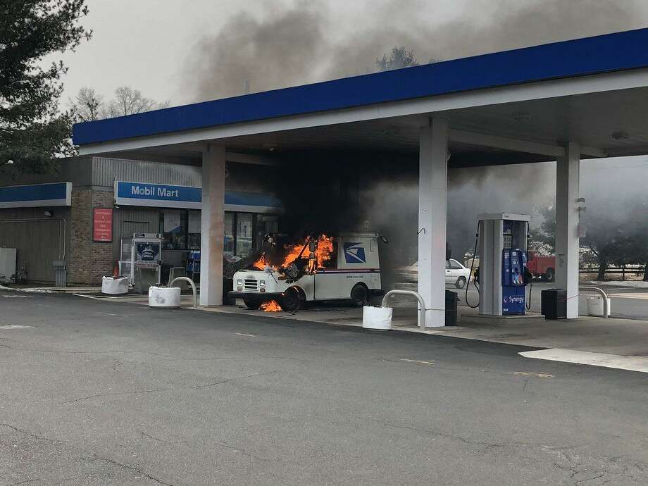 North Haven firefighters extinguished a blazing vehicle at 276 Washington Ave. Wednesday. Photo: North Haven Fire Department
