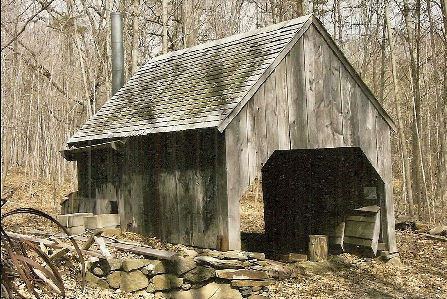 A reconstruction of the original sugar house at Dudley Farm where maple syrup is produced as it was on the farm in the late 19th century. There will be a demonstration at the Winter Farmers Market on Saturday. Photo: Contributed Photos