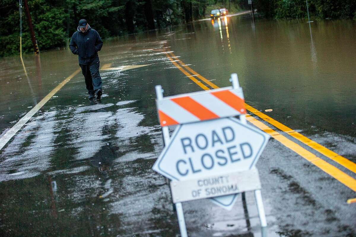 Chris Puppione checks out the flood along River Road and Mirabel Road on Wednesday, Feb. 27, 2019, in Forestville, Calif. Puppione lives nearby in the Mirabel Heights neighborhood, where there's an evacuation order.