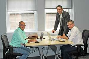 """MEWS+, the Middletown Entrepreneur Work Space, works with Tim Laubacher, left, a local entrepreneur and experienced co-worker, to """"animate"""" the space. At center is Jeffrey Pugliese, vice president of the Middlesex County Chamber of Commerce, and at right is Ryan McAraw of Sound Web Solutions."""