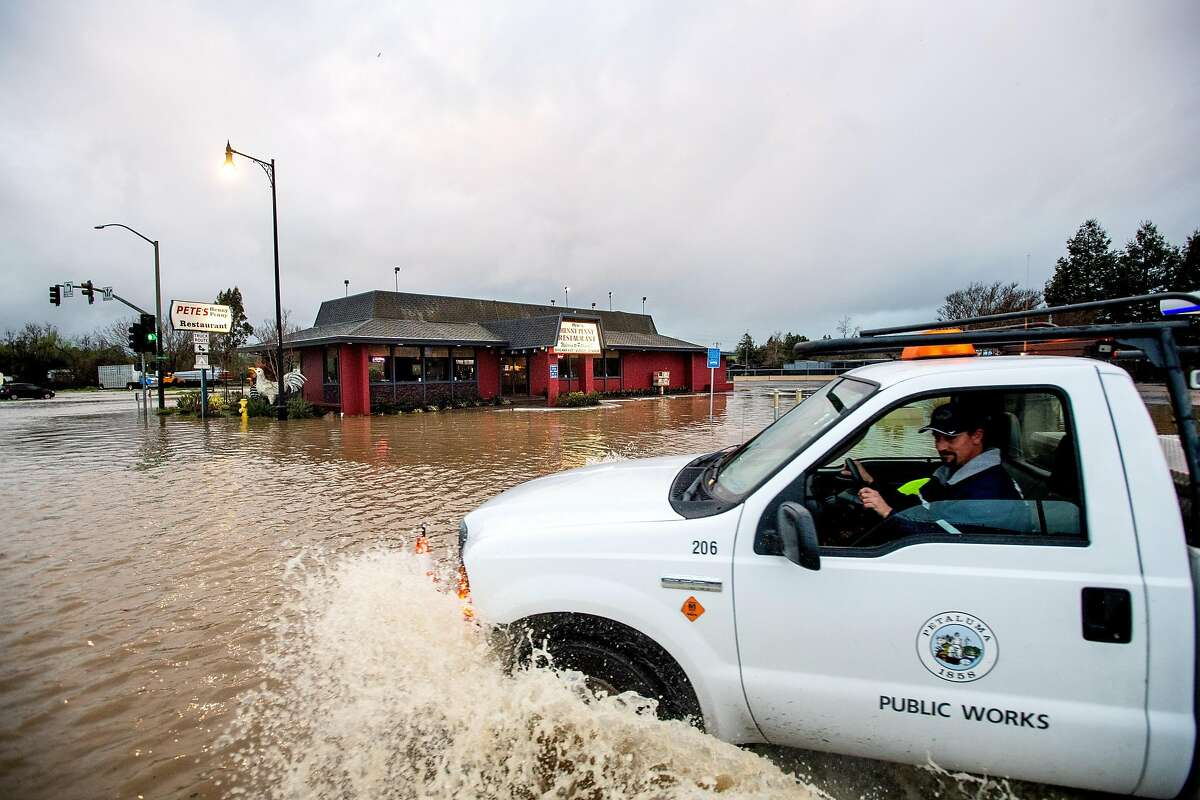 Flood waters cover Petaluma Blvd. North and Stony Point Rd. on in Petaluma, Calif., on Wednesday, Feb. 27, 2019. Emergency responders rescued motorists and residents from the area.