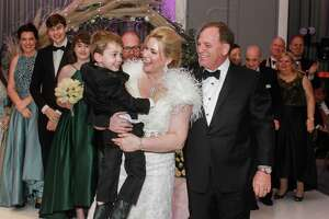 EMBARGOED FOR SOCIETY REPORTER UNTIL FEB. 25 After the wedding ceremony of Stephanie von Stein and Dr. Mark Schusterman at the Ars Lyrica gala, Stephanie is holding her son, William.