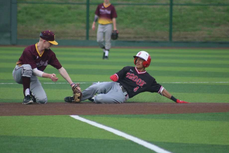 Deer Park second baseman Dylan Stone makes the tag on a Clear Brook runner during last Saturday's game at Barbers Hill High School. Stone will be one of the new faces up the middle for the Deer defense. Photo: Robert Avery