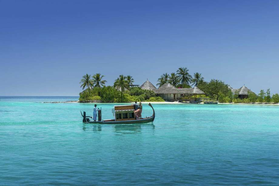 FILE — For years the subject of fantasy photo spreads in glossy magazines, featuring luxe bungalows on stilts, in unreal aquamarine water, the Maldives was an obvious choice for Olivia and Raul De Freitas' romantic getaway. Photo: Four Seasons / Four Seasons / Ken Seet