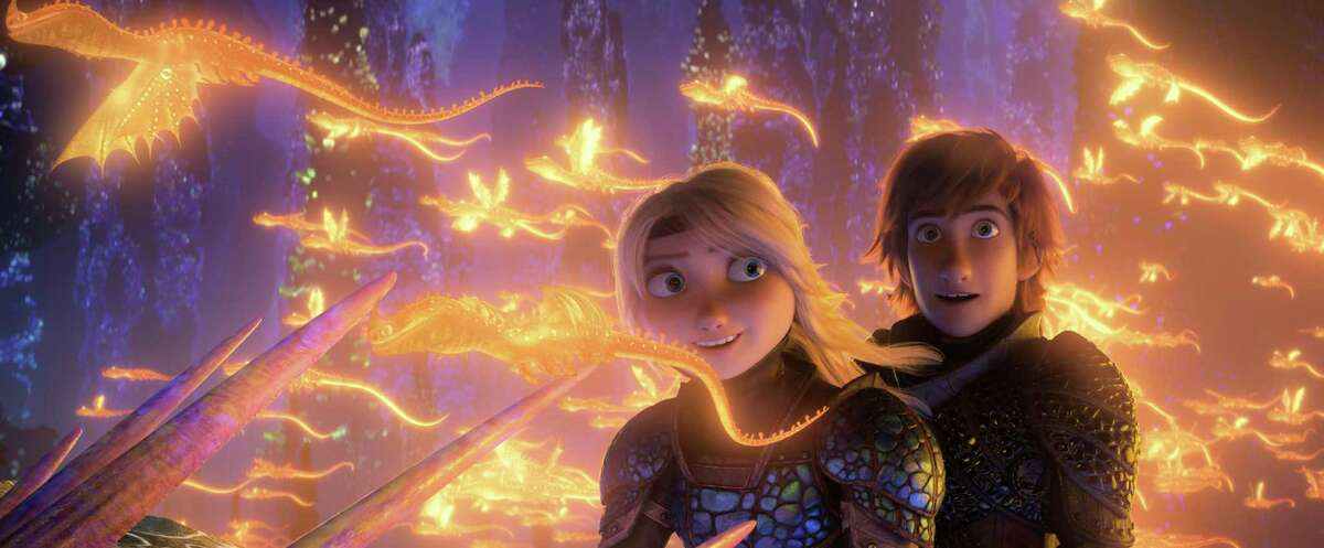 This image released by Universal Pictures shows characters Astrid, voiced by America Ferrera, left, and Hiccup, voiced by Jay Baruchel, in a scene from DreamWorks Animation's