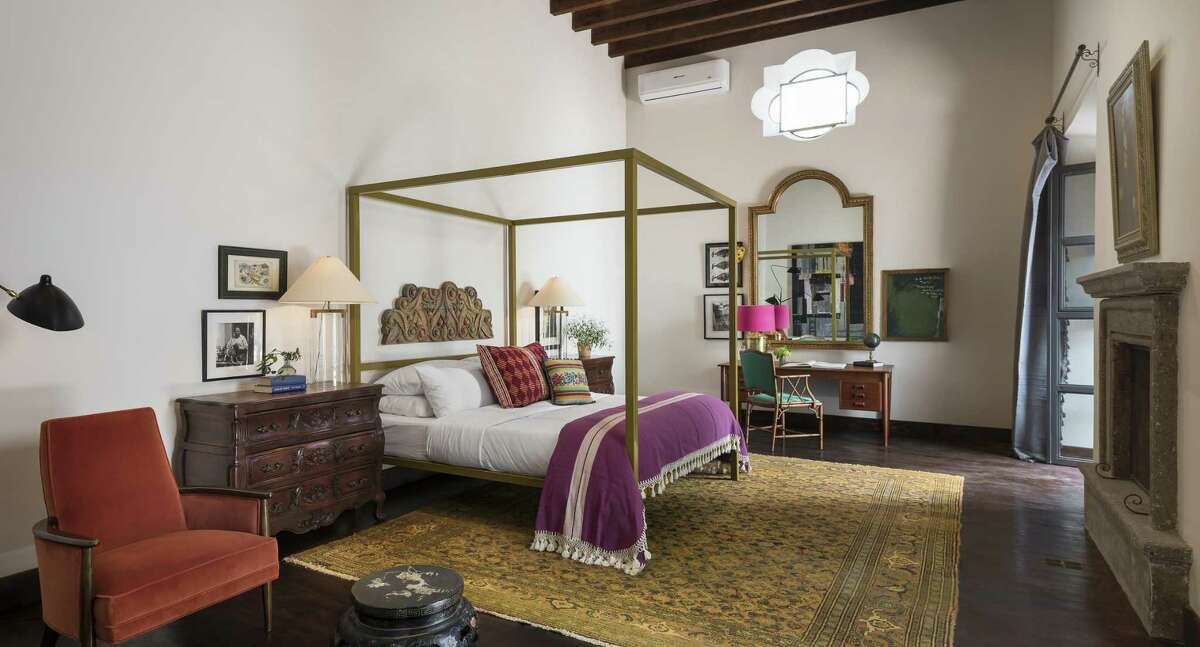 The Amparo room, in what was formerly the home's master suite, has a king-size, powder-coated steel bed, above which hangs a carved wood fragment.
