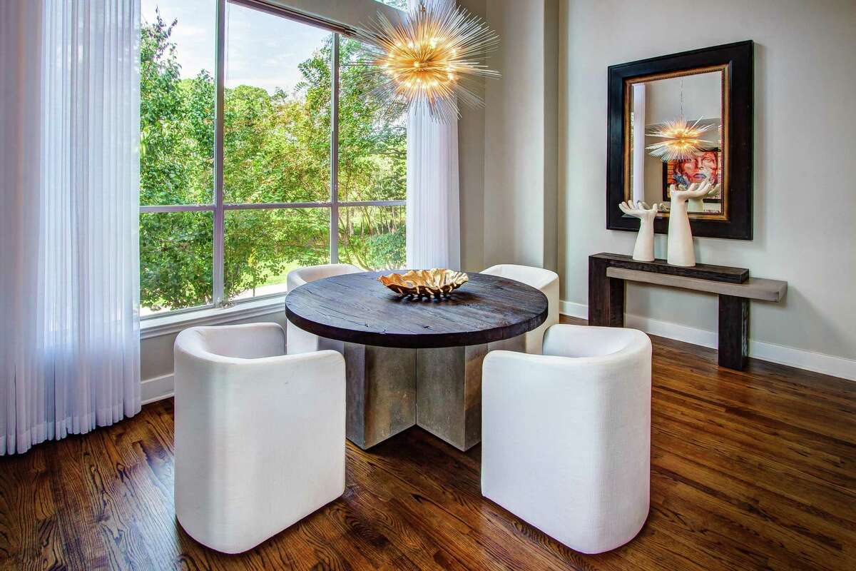 Lighting from Visual Comfort -- a Houston lighting company -- fills the Snows' home.