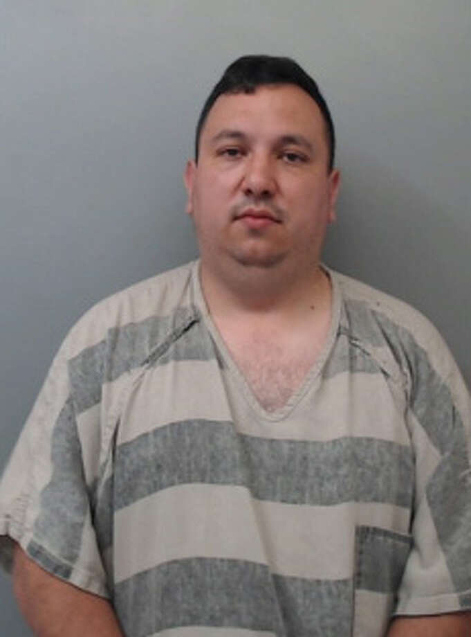 Orlando Alejandro Garza, 34, was charged with aggravated assault with a deadly weapon, driving while intoxicated and resisting arrest. Photo: Webb County Sheriff's Office